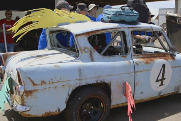 A Ford Anglia is inspected before a 24 Hours of LeMons race at High Plains Raceway in Deer Trail, Colorado.